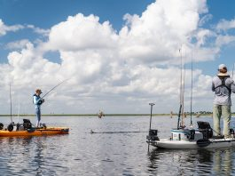 two anglers standup fishing from their anchored fishing kayaks