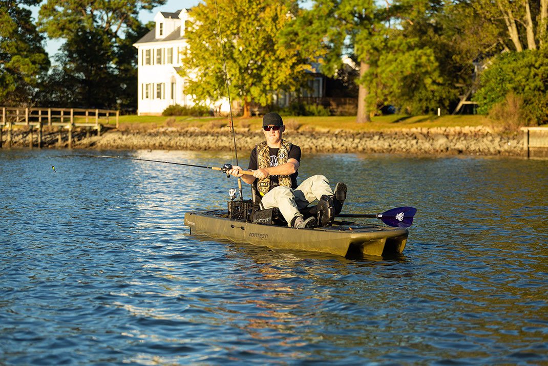 Man fishes from a Point 65 KingFisher modular kayak