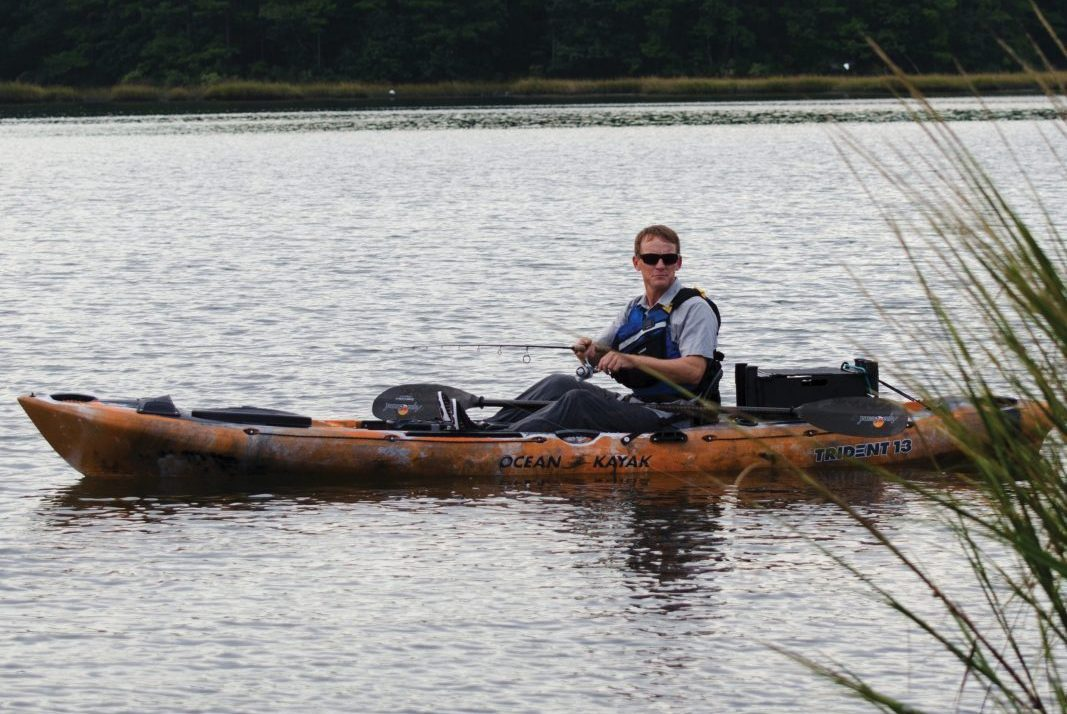 man fishing out of an Ocean Kayak Trident 13