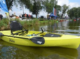 Hobie Mirage Compass kayak sits at the river's edge