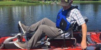 man pedals the Jackson Coosa FD kayak