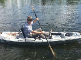 man paddles the Pelican Catch 100 fishing kayak