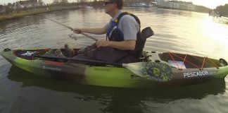 man fishes from a Pescador Pro 120 boat from Perception Kayaks