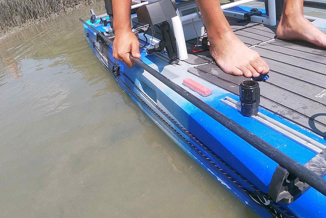 the stake is mounted on the side of a kayak with paddle holders