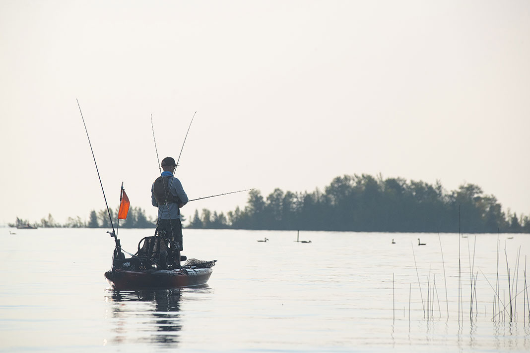 man kayak fishing with his new Father's Day gifts