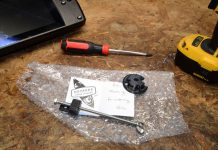 transducer adapter from a grassroots kayak fishing gear supplier sits on a workbench