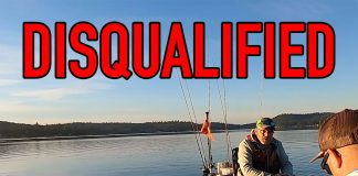 angler is disqualified from a kayak bass fishing tournament by the tournament director