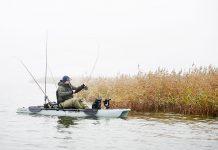 man fishes from a modular or folding kayak