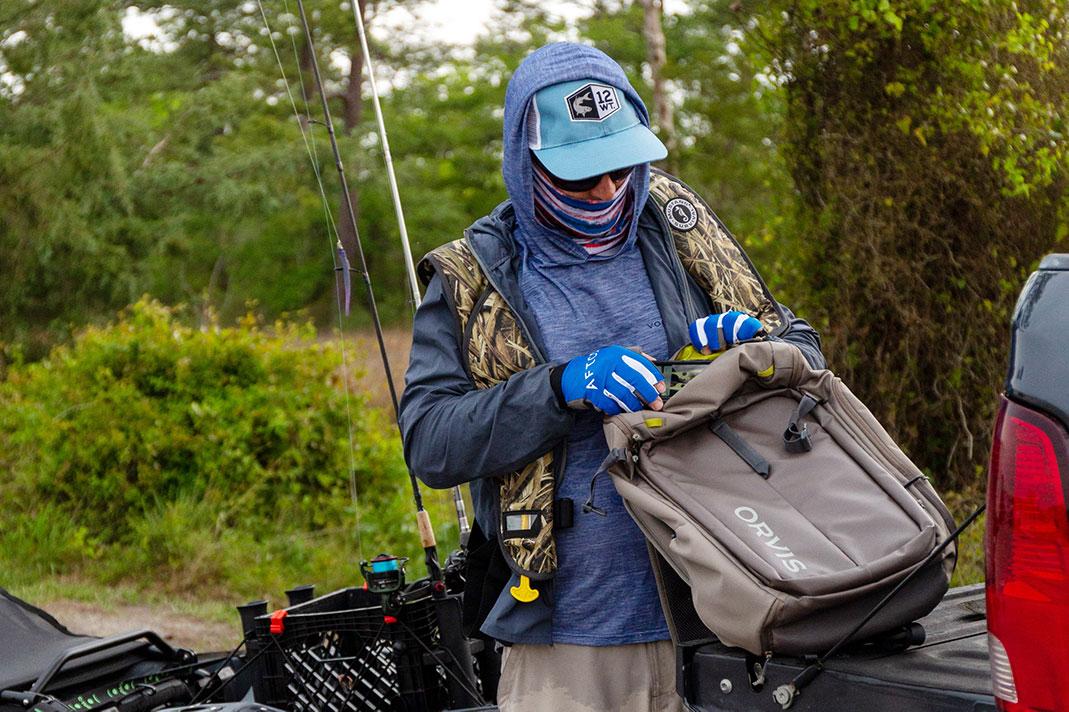 angler wears foul weather fishing gear