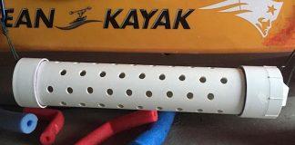 a white DIY live bait tube lies on the garage floor