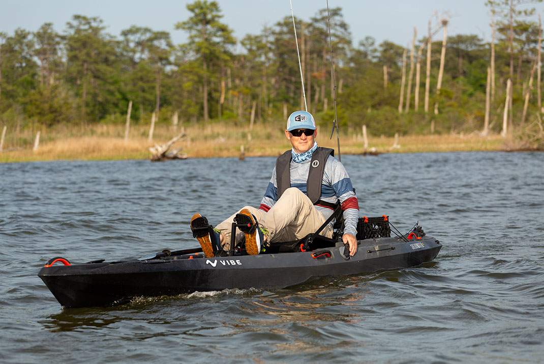 man pedals the Vibe Shearwater 125 fishing kayak