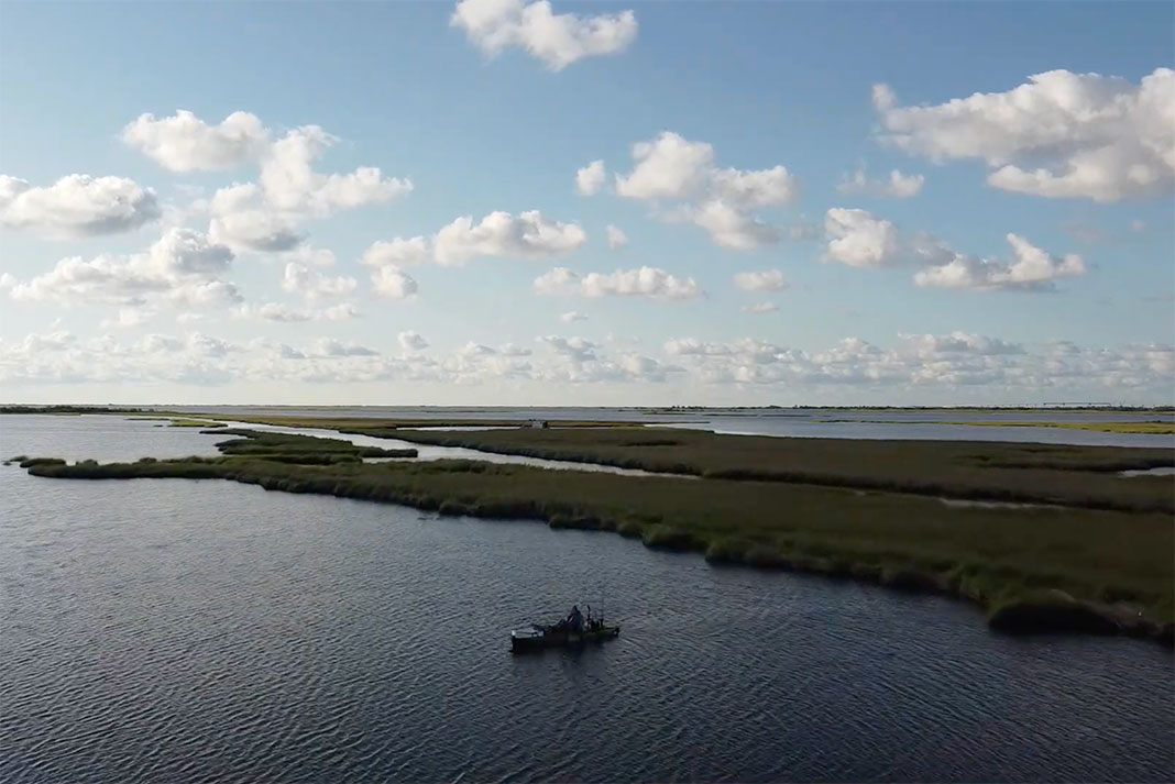 fishing kayak in Louisiana grass flats sight fishing with drone for redfish