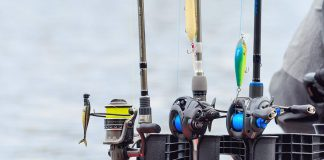 three fishing rod and reel combos all lined up and ready for action.