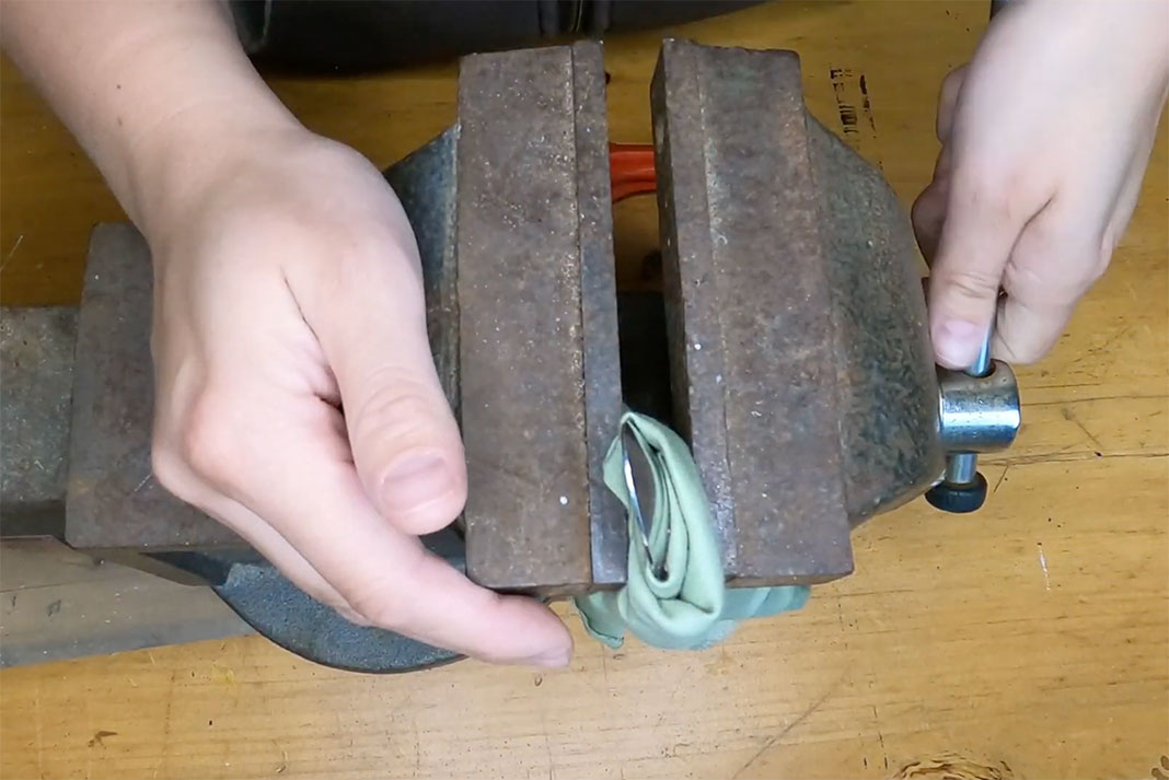 squeezing the spoon in a vise to change the curvature