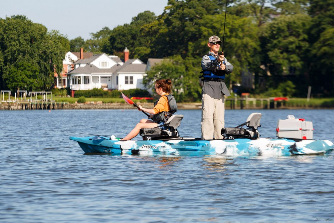 Two people fishing on a tandem kayak